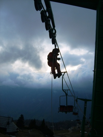 Repairs on a two-seater chair lift